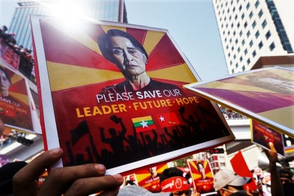 Protesters hold signs with an image of Aung San Suu Kyi as they take part in a demonstration against the military coup in Yangon, Myanmar, on 22 February 2021. (Sai Aung Main/AFP)