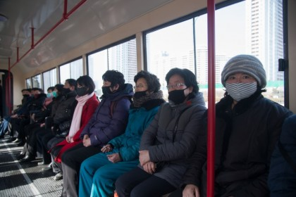 Commuters wearing face masks ride a tramcar in Pyongyang on February 26, 2020. (Kim Won-Jin/AFP)