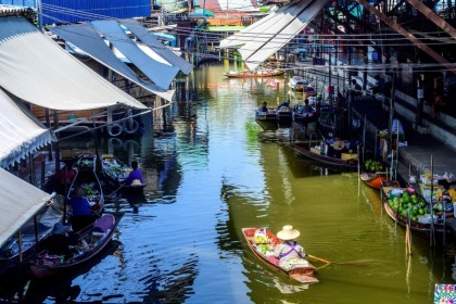 This photograph taken on 8 December 2020 shows a vendor steering her boat while looking for customers at the Damnoen Saduak floating market, nearly deserted with few tourists due to ongoing Covid-19 coronavirus travel restrictions, some 100km southwest of Bangkok. (Mladen Antonov/AFP)