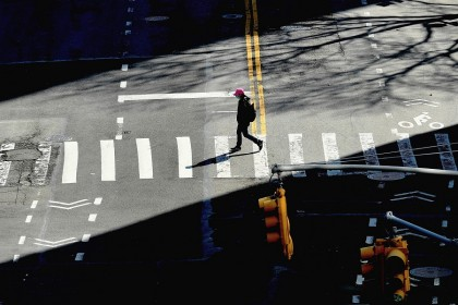 A person crosses the street on 27 March 2020 in New York City. (Angela Weiss/AFP)