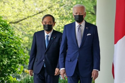 US President Joe Biden and Japan's Prime Minister Yoshihide Suga walk through the Colonnade to take part in a joint press conference in the Rose Garden of the White House in Washington, DC on 16 April 2021. (Mandel Ngan/AFP)