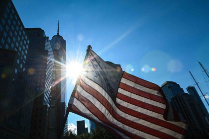 A US flag flutters in the wind near the National 9/11 Memorial & Museum on 10 September 2021 in the US. (Roberto Schmidt/AFP)