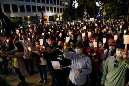 People attend a vigil commemorating the 32nd anniversary of the 1989 Tiananmen square pro-democracy protests and crackdown outside of the Chinese consulate in Los Angeles, California on 4 June 2021. (Patrick T. Fallon/AFP)
