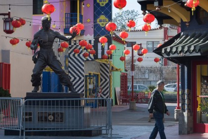 In this photo taken on 13 February 2020, a man walks by a deserted Los Angeles Chinatown as most stay away due to fear of the Covid-19 epidemic. (Mark Ralston/AFP)