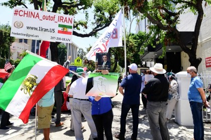 Iranian-Americans protest China's bypassing of US sanctions in doing business with Iran, as well as what they believe as the handing over of Kish island in the Persian Gulf to China in exchange for military, regional and international support, in front of the Chinese Consulate in Los Angeles, California on 10 July 2020. (Frederic J. Brown/AFP)