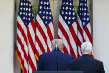 US President Donald Trump (L) and US Vice President Mike Pence return to the Oval Office after a press conference on the coronavirus at the White House in Washington, DC, April 27, 2020. (Mandel Ngan/AFP)