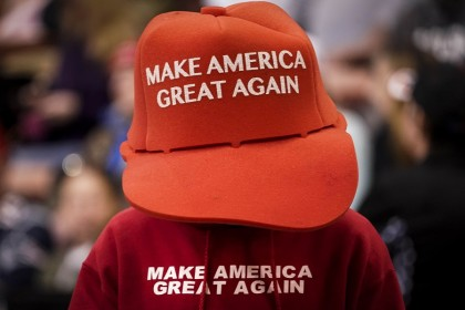 "A supporter of US President Donald Trump wears an oversize ""Make America Great Again Hat"" as he waits for the start of a ""Keep America Great"" rally at Southern New Hampshire University Arena on 10 February 2020 in Manchester, New Hampshire. (Drew Angerer/Getty Images/AFP)"