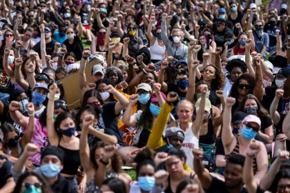 Demonstrators raise their fists as they gather on 2 June 2020 in Saint Paul, Minnesota, to protest the death of George Floyd while in police custody. (Chandan Khanna/AFP)