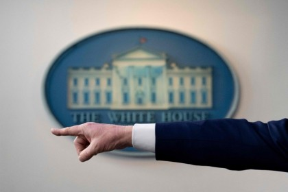 US President Donald Trump's hand is seen as he points to take a question during a Coronavirus Task Force press briefing at the White House in Washington, DC, April 19, 2020. (Jim Watson/AFP)