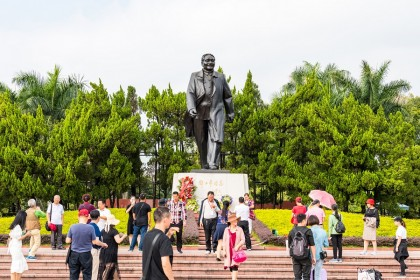Tourists taking photos in front of a statue of Deng Xiaoping in Lianhuashan Park, Shenzhen, China. (iStock)