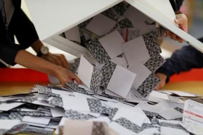 Officials open a ballot box at a polling station in Kowloon Tong, Hong Kong. (Athit Perawongmetha/REUTERS)